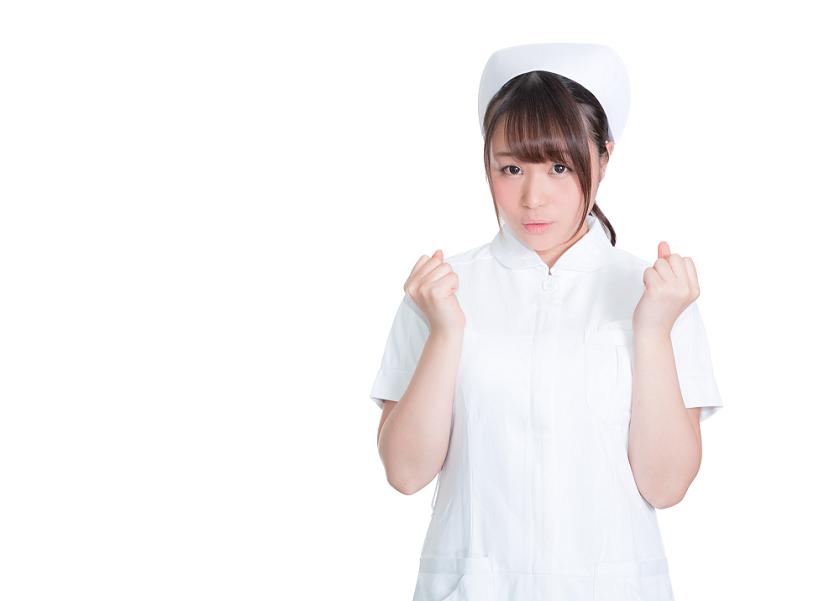 ガッツポーズの女性看護師